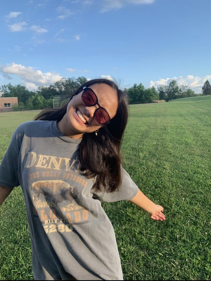 Soaking in the sunlight, junior Aly Ignacio's bright personality shines through. One of Aly's favorite activities is taking pictures outside with her friends.