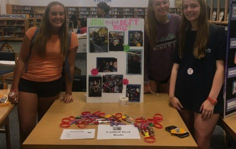 Seniors Sophie Boulware, Haley Yopp, and Caroline Cabaniss promote the Unified Best Buds Club at the 2018 Club and Activities fair. Here, they provided information about the club and welcomed new members.