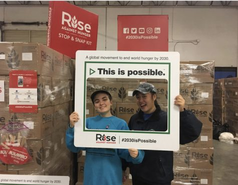 Working hard for Rise Against Hunger last December, former Key Club members Sam McCreary and Emily Ni volunteer their time to help others. Even though Key Club's service projects may look different this year due to social distancing, they are still trying to get help to those who in need this holiday season.