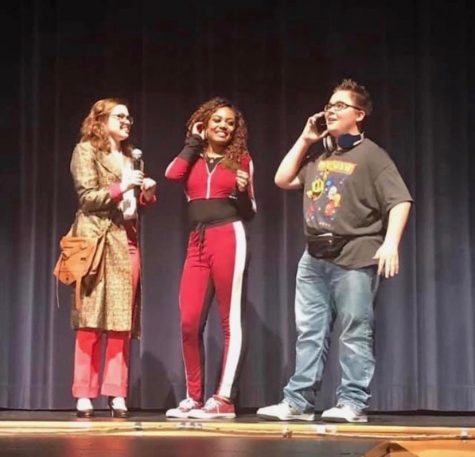 Performing with his cast mates senior Natalie Kincaid (left) and alumni Brianna Flowers (middle), Andrew's passion for theater shines through. Andrew has managed to get lead roles throughout his high school career  and is a very talented performer.