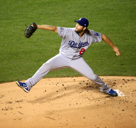 Going through his signature wind-up, pitcher Clayton Kershaw gets ready to deliver a pitch. Kershaw was finally able to win his first championship after a long history of postseason disappointment during his time with the Dodgers.