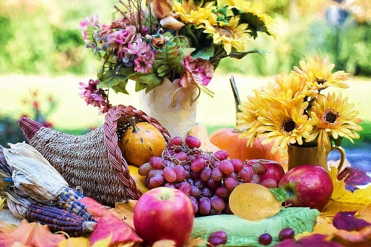 Warm+colored+floral+arrangements+or+cornucopias+filled+with+fruits+and+vegetables+are+the+perfect+items+to+decorate+with+for+Thanksgiving.+These+notoriously+festive+fall-like+decorations+are+just+some+of+the+numerous+traditions+used+to+celebrate+the+approaching+holiday.