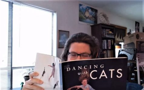 Pretending to read Dancing with Cats, Mr. Oliver shares with us a glimpse of his light-hearted sense of humor. Mr. Oliver has read an impressive number of books, yet he chose this one, displaying his humble character.
