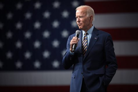 Pictured while addressing an audience, President Joe Biden takes on his new role amidst a deadly pandemic. He has been record-breakingly active throughout his first month of presidency, signing tens of executive orders with no sign of slowing down.