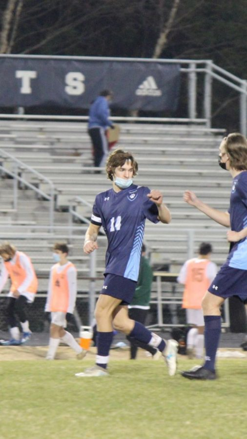 Running back after a goal was scored, in their first game, Will Jurney fist-bumped fellow senior Callum Monteith. This goal scored here would not be enough to win against Enloe,  but is the only loss the boys have had thus far.