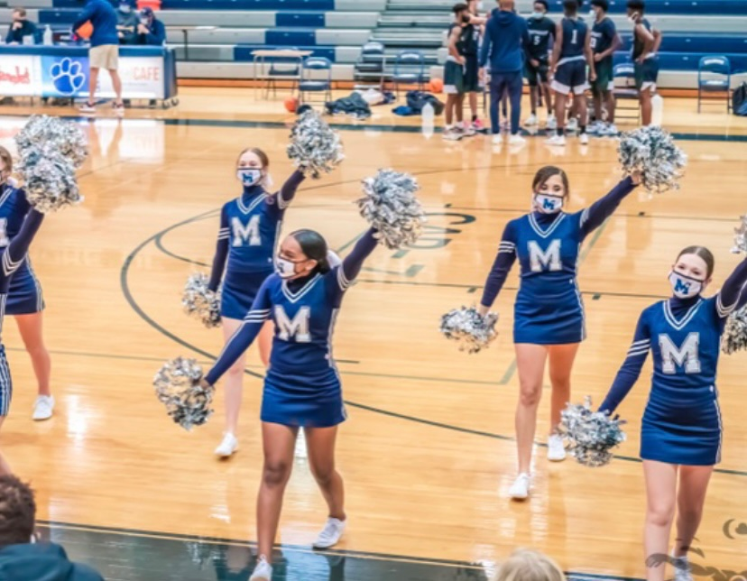 Cheering+on+the+Wildcats%2C+Madison+Solomon+%28front+middle%29+cheers+on+the+team+with+the+other+JV+cheerleaders.+This+is+just+one+of+the+ways+Madison+shows+her+school+spirit+at+Millbrook.+