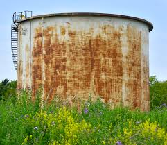 Resting on top of a field of bushes and greenery, this oil tank is similar to the one in which the bodies of Celeste and Bella Watts were discovered. Ther mother, Shannan, was found in a shallow field nearby.