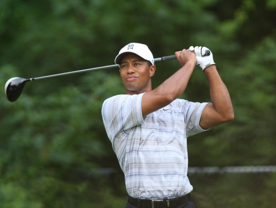 Observing his shot, Tiger Woods follows through with his club. It is possible that this accident may leave Woods unable to play golf ever again.