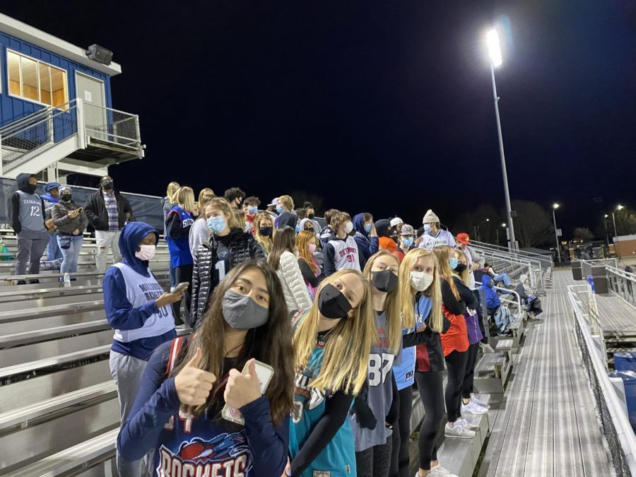 Millbrook Maniacs (Lauren McShae, Lauren Harris, Mary Buffaloe, and Emily Wagner in the front row) socially distance to watch the Wildcats win their first football game of the season. The stands were not fully filled, but the school spirit was there to cheer on their team.
