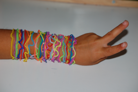 A student shows off an assortment of Silly Bandz on their wrist which became very popular among Gen Z children in the 2010s. Silly Bandz are no longer sold, becoming obsolete after being banned by most elementary schools for causing too much distraction among students.