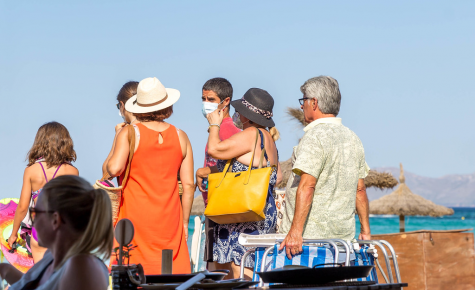 Out and about, beachgoers in Mallorca, Spain, do their best to both cool themselves off and keep safe during the coronavirus pandemic. Vacationers should continue to follow health expert's guidelines during the upcoming spring break.
