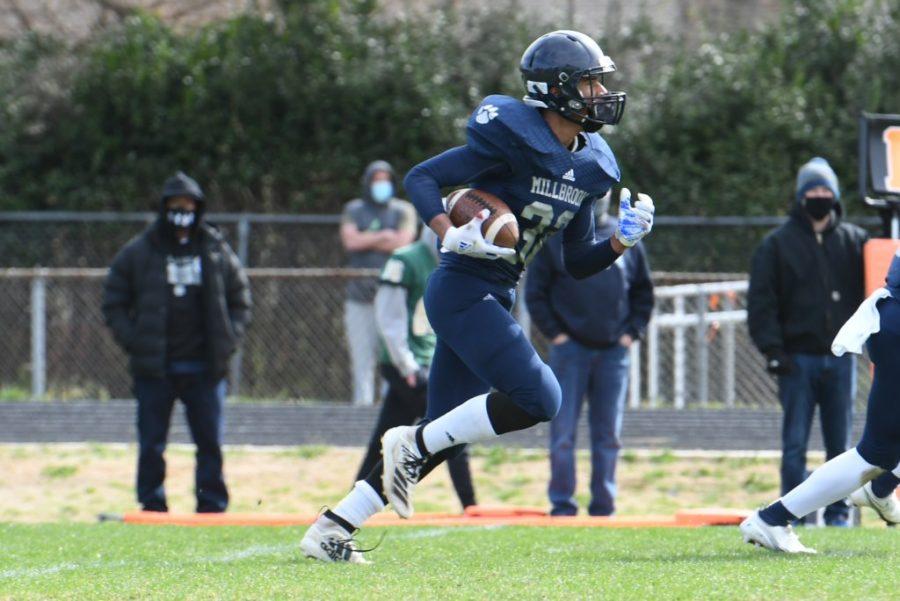 Running across the field, Jayden Ferguson tries to earn a touchdown for Millbrook. Being on the JV football team is Jayden's favorite activity.