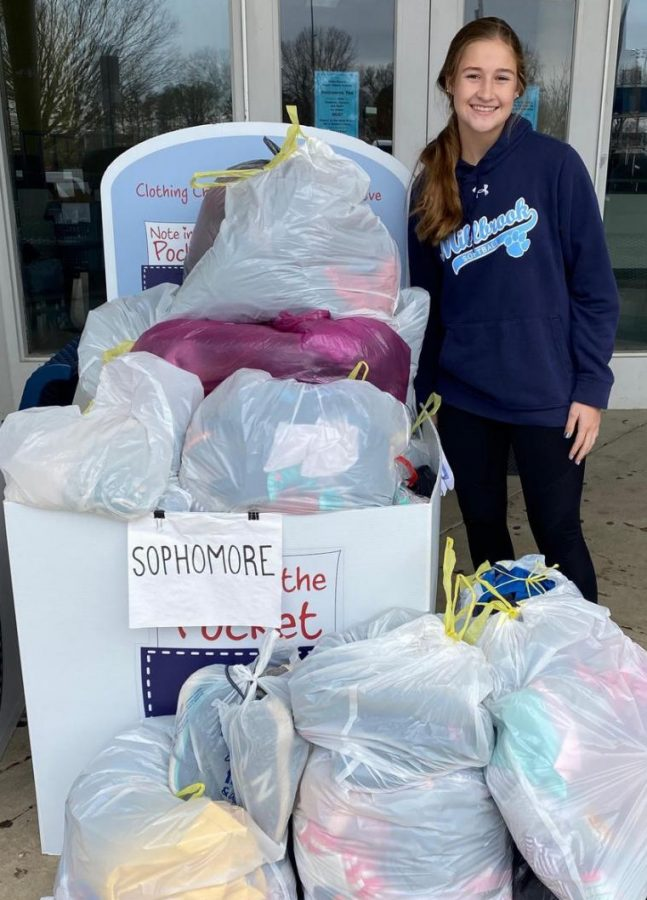 Standing beside the clothes drop-off for Note in the Pocket, Madison Long celebrates the amount of clothes that were given. Madison, the current Vice President of the Class of 2023, represents her school by helping and giving back to the Millbrook community.