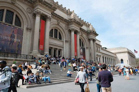 People gather during their day-to-day life on the esteemed Met steps. The Met Gala is held at the Metropolitan Museum of Art in New York.