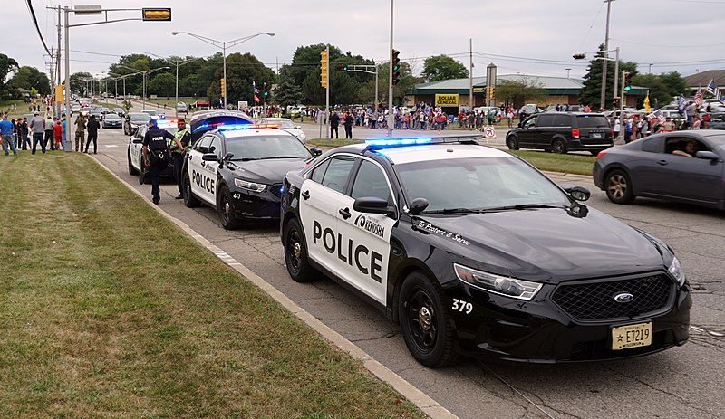 Police surround high school while in lockdown. They are telling parents to stay calm and wait until they say it is safe.