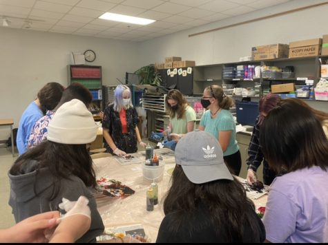 Reuniting again, Art Club comes together for their first in-person activity of the 2021-2022 school year. Full of chatter and laughter, students of all statuses come together to create a tie-dye