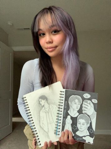 Smiling, senior Skylar Chan shows off her hand drawn artwork. This outstanding student's talent stands out from the crowd.
